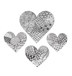 Four ornated zentangle hearts vector image