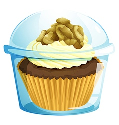 A cupcake inside a transparent container vector