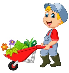 Cartoon little boy holding wheelbarrow vector