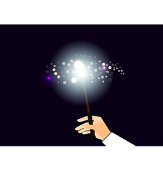 Hand holding a magic wand vector image