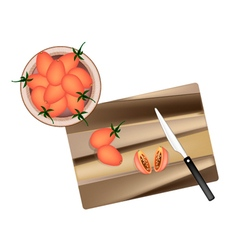Fresh red grape tomatoes on cutting board vector