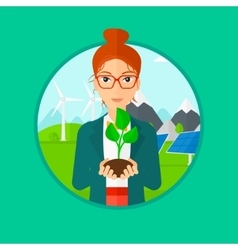 Woman holding green small plant vector