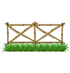 A bamboo fence with grass vector