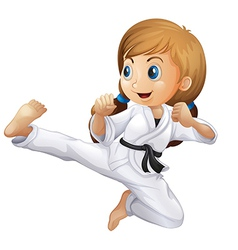 A young girl doing karate vector image