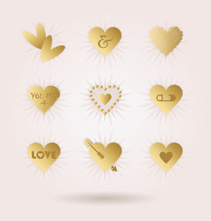 Golden abstract hearts icons set with sun beams vector