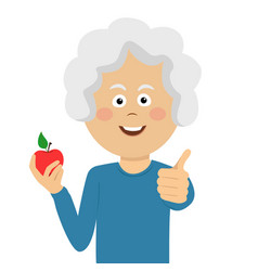 woman holding a red apple giving thumbs up vector image