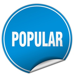 Popular round blue sticker isolated on white vector