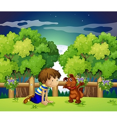 A boy and his pet playing outdoor vector