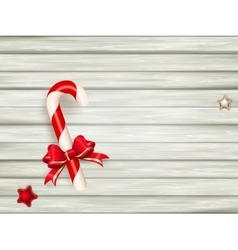 Candy cane on wooden board eps 10 vector