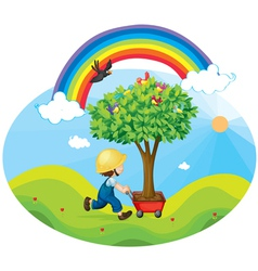 boy carrying tree vector image vector image