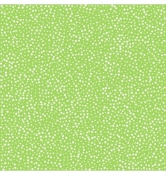 Dots on green background seamless pattern vector