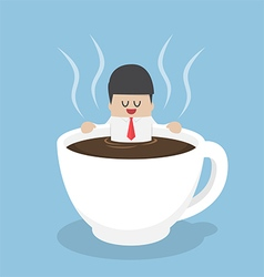 Businessman relaxing in a cup of coffee vector image