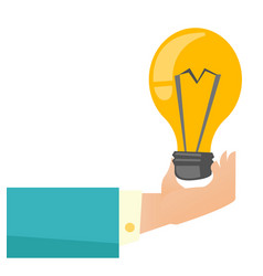 Hand of business person holding bright light bulb vector