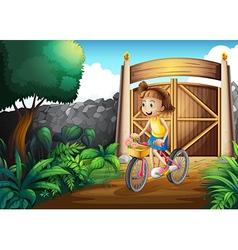 A child biking at the yard vector image vector image