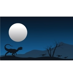 Silhouette of dilophosaurus with moon vector