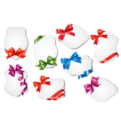 Set of gift cards with colorful gift bows with vector