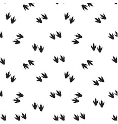 Minimal seamless pattern with dinosaur foots vector