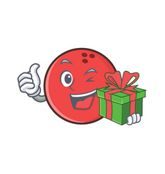 Bowling ball character cartoon with gift vector