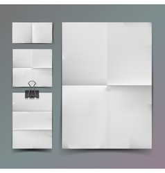 White folded paper set and paperclip vector image