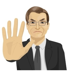 Angry mature businessman showing stop gesture vector