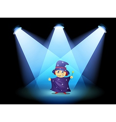 A magician standing at the stage with spotlights vector