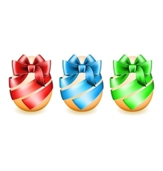 Easter eggs wrapped in ribbon vector