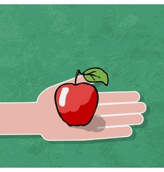 Hand gives a red apple vector