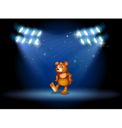 A stage with a bear dancing at the center vector