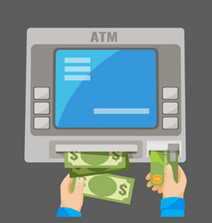 hand inserting credit card into grey atm and vector image
