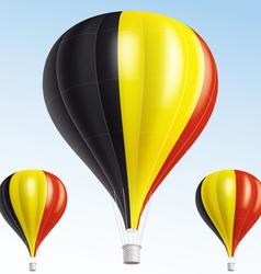 Hot balloons painted as belgium flag vector