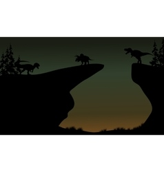 Silhouette of triceratops and allosaurus vector