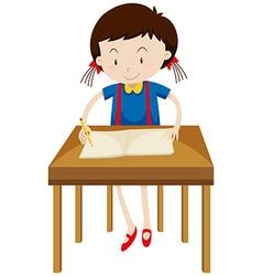 Little girl writing on blank book vector