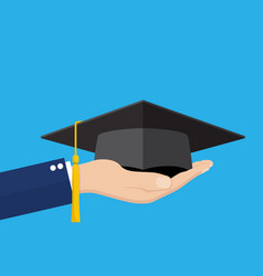 hand holding graduation cap vector image vector image