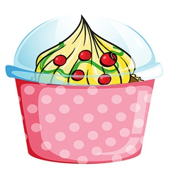 A cupcake inside a dotted pink container vector
