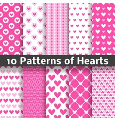 Heart shape seamless patterns tiling vector image