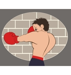 Young boxer in blue shorts trained against a brick vector