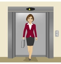 Businesswoman coming out of office elevator vector