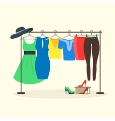 Clothes racks with women wear on hangers vector