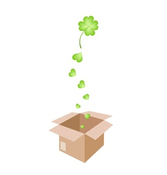 Beautiful four leaf clovers in a shipping box vector