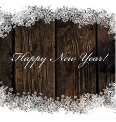 Happy new year greeting on wooden background vector