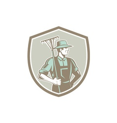 Organic farmer rake shield woodcut retro vector