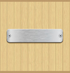 Metal plate on wooden background vector