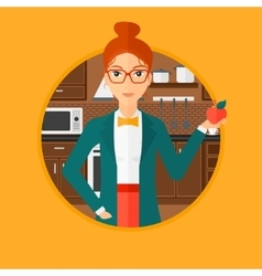Young woman with apple in the kitchen vector