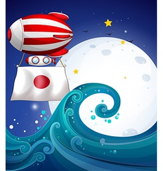 A floating balloon with the flag of japan vector