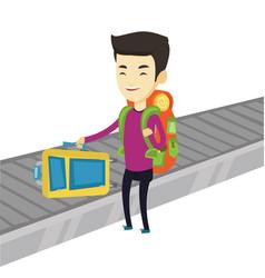 Man picking up suitcase on luggage conveyor belt vector