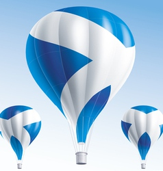 Hot balloons painted as scottish flag vector