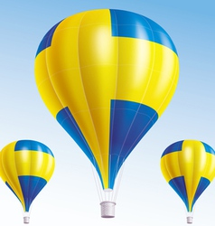 Hot balloons painted as swedish flag vector