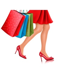 Waist-down view of shopping woman wearing red high vector