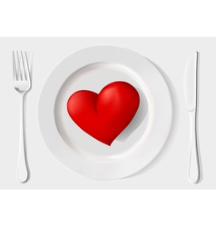 Red heart on a plate fork and knife on a white ba vector