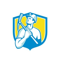 Coal miner holding pick axe looking up shield vector